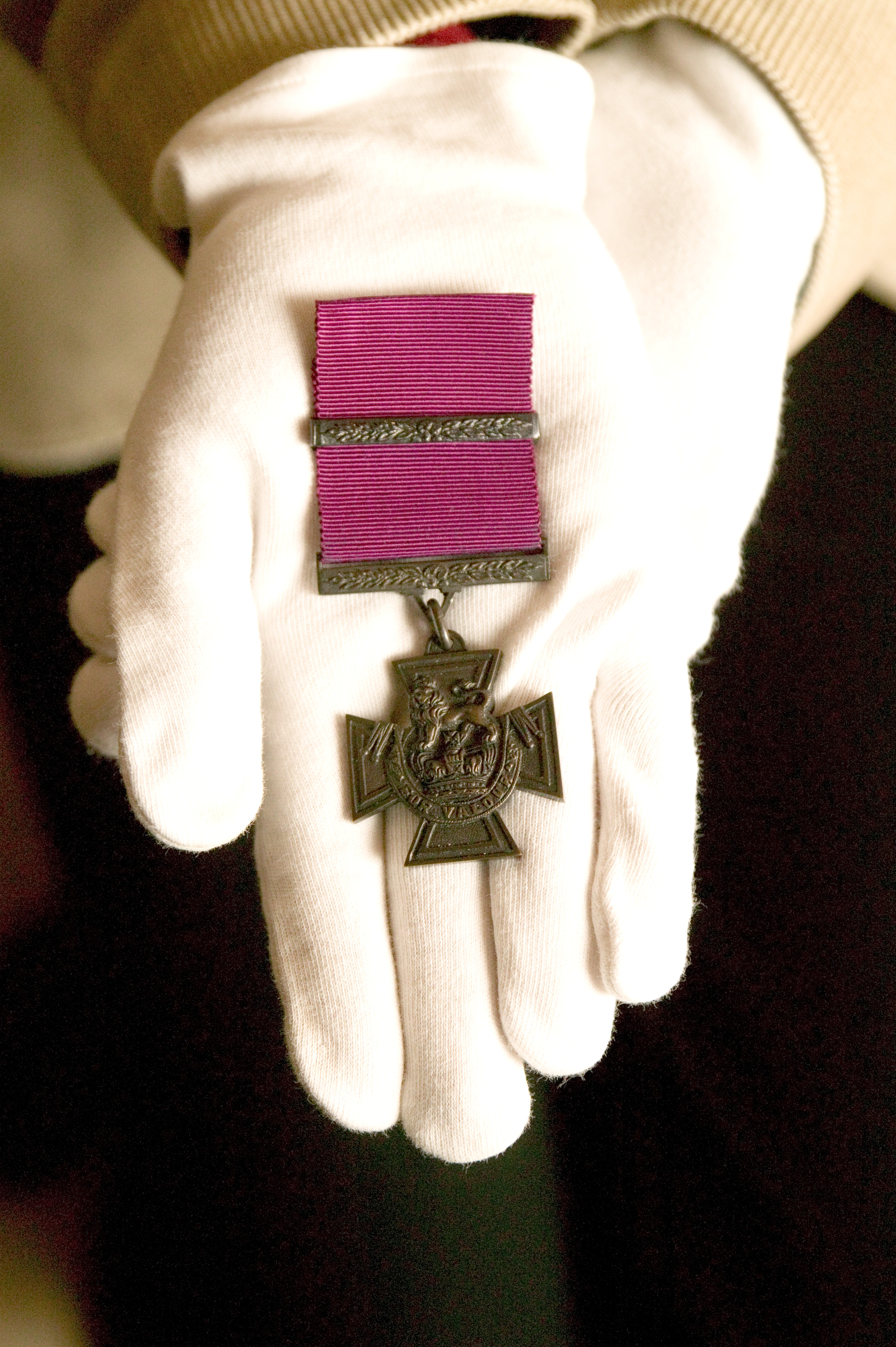 The actual specimen Victoria Cross medal that was approved by Queen Victoria in the nineteenth century.   Instituted by Queen Victoria to cover all actions since the outbreak of the Crimean War in 1854, the Victoria Cross has been awarded 1356 times and 3 bars have been awarded.   The most recent recipient of the VC is Corporal Bryan Budd, of the 3rd Battalion The Parachute Regiment, who was posthumously awarded the VC for acts of 'inspirational leadership and the greatest valour' in Southern Afghanistan in 2006.  In 2004 Private Johnson Beharry from 1st Battalion the Princess of Wales's Royal Regiment was awarded the honour for two separate acts of outstanding gallantry of the highest order whilst based in Al Amarah, Iraq.  The VC is made from the bronze of Russian guns captured at Sebastopol, though modern research suggests that Chinese guns may have been used at various times.