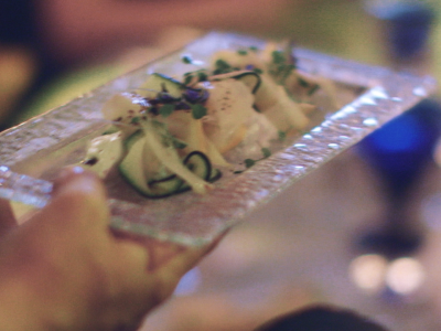 Square Events - food in hand on glass plate
